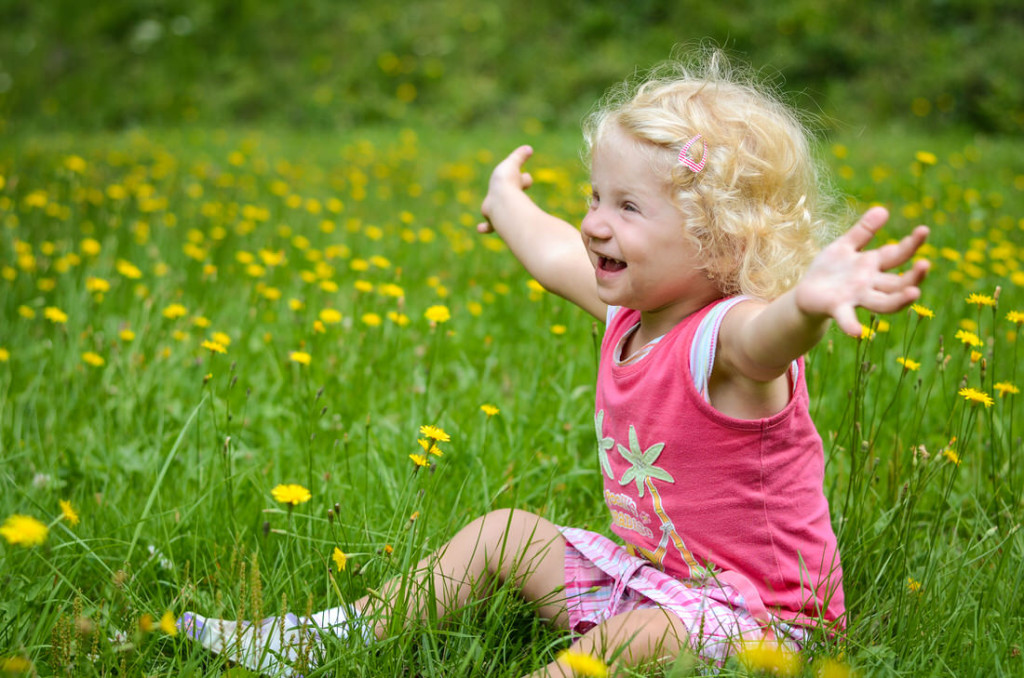 Girl in green grass sustainable design